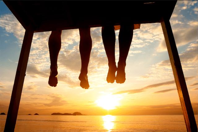 legs pier sunset feet toes silhouette dangling summer orange yellow black