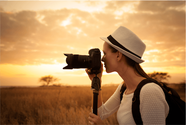 lady camera hat wild sunset tripod photographer