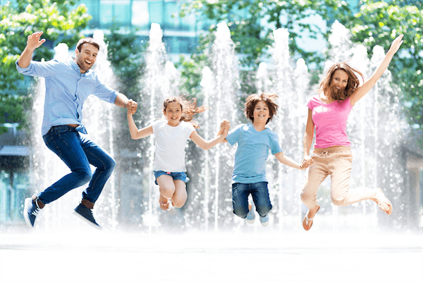 family portrait jumping kids mum and dad parents water fountain happy lifestyle iphotography