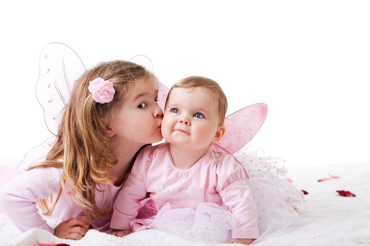 sister and sibling posing