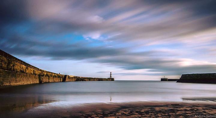 water harbour long exposure calm sky landscape lighthouse