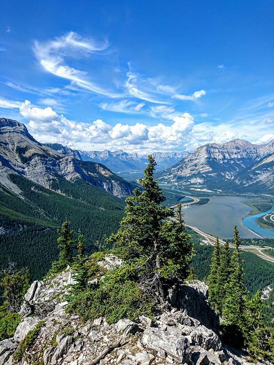 landscape blue sky clouds rocks hills mountains tree