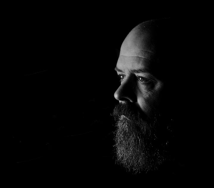 man portrait black and white beard low key lighting photography