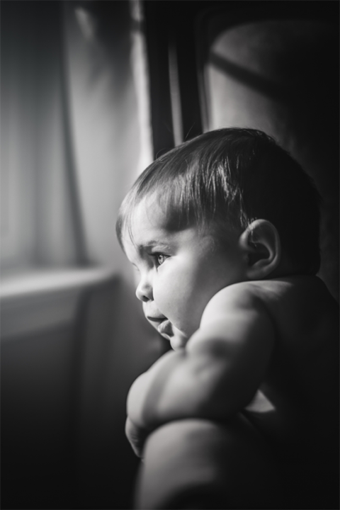 subject portrait black and white looking window candid