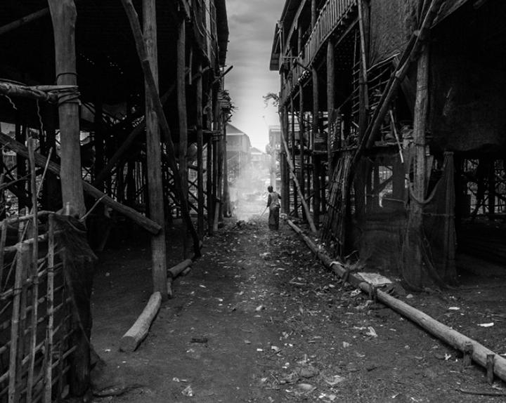 black and white documentary wood steam smoke urban
