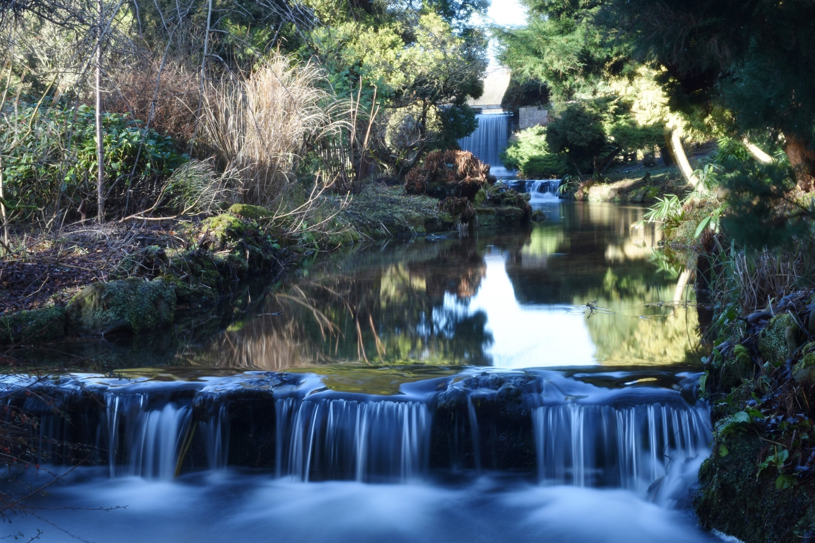 waterfall long exposure calm white blue green stream