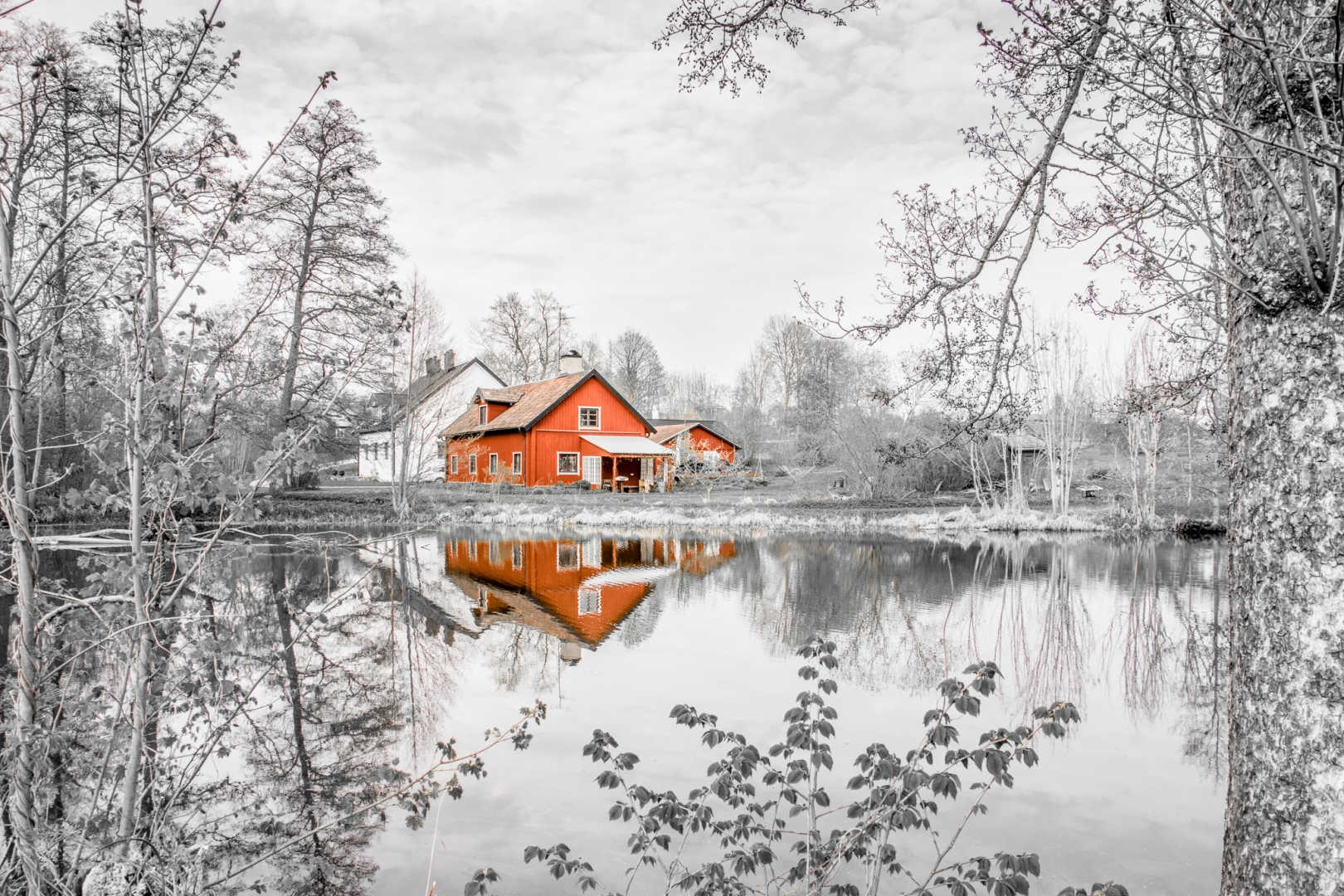 house lake monochome red split colour reflection