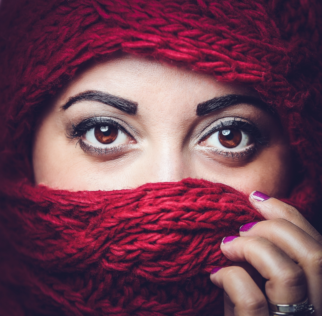 eyes red scarf hands purple finger nails face close up