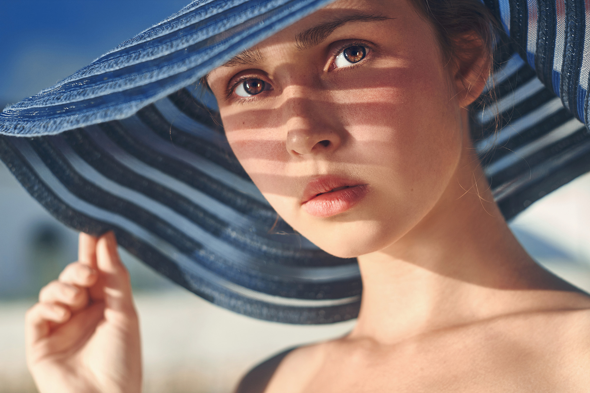 female hat portrait photography blue shadow face