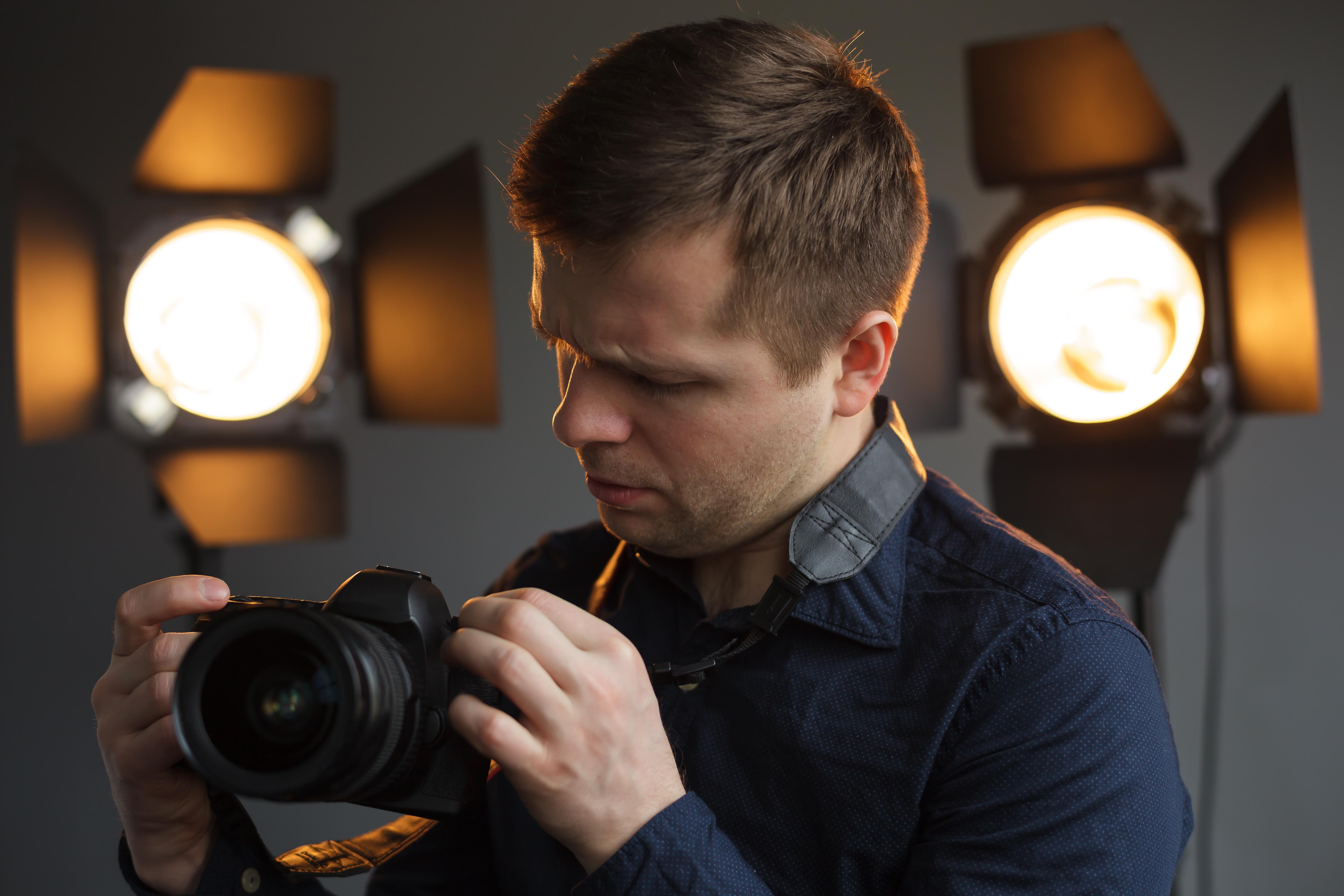 man camera photographer studio light barn doors