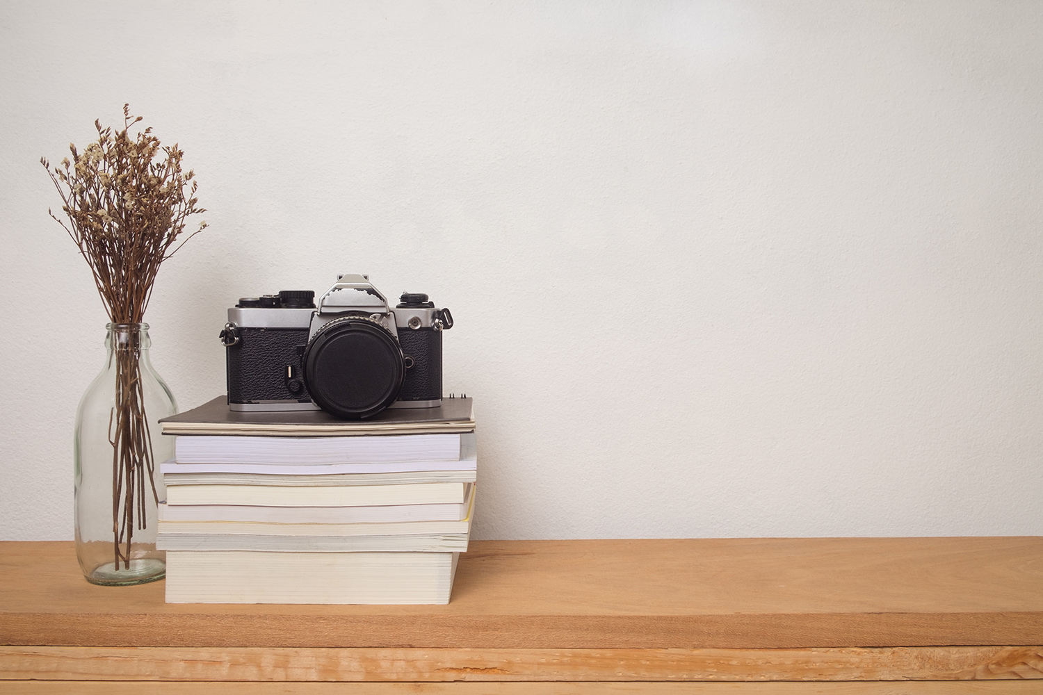 camera film photography books desk creative block