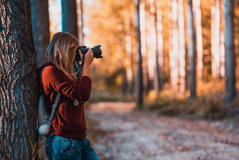 female camera woods photographer
