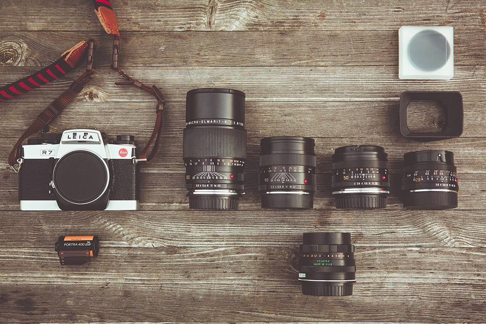 camera lens table flat lay retro canon