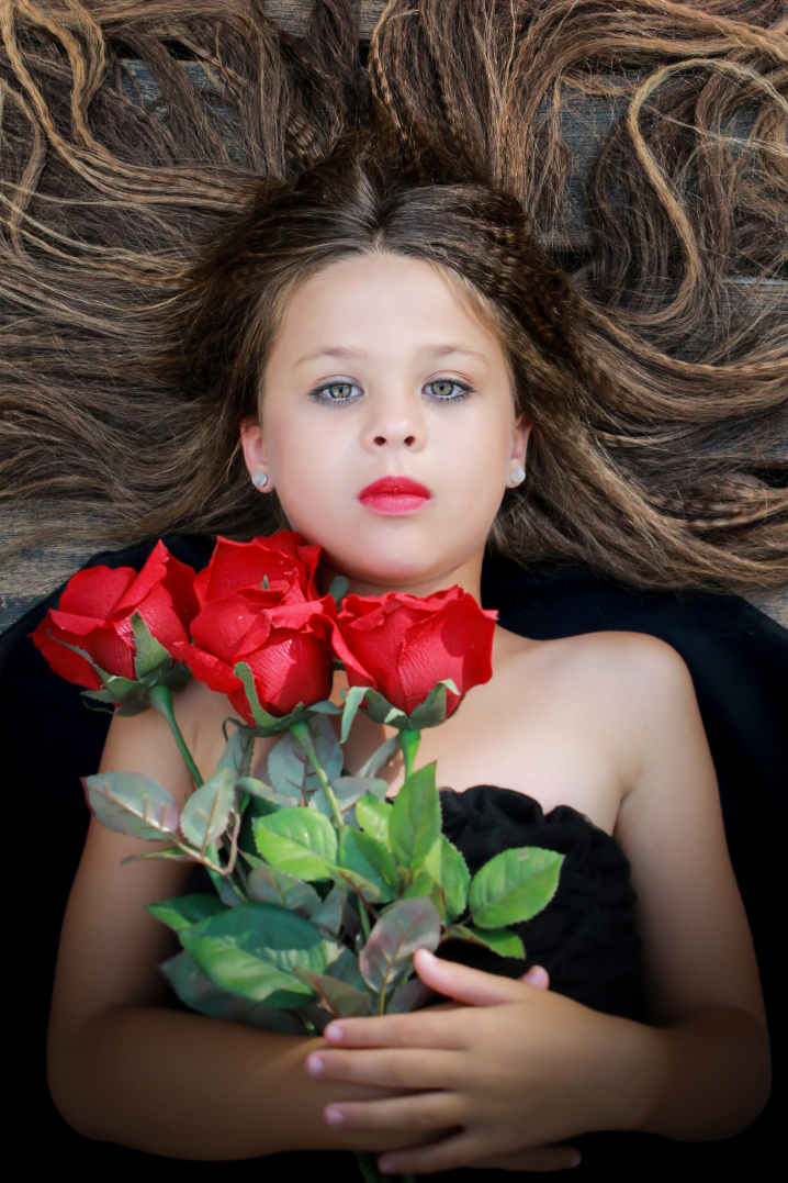 girl portrait red roses flowers hair crinkley overhead angle photography
