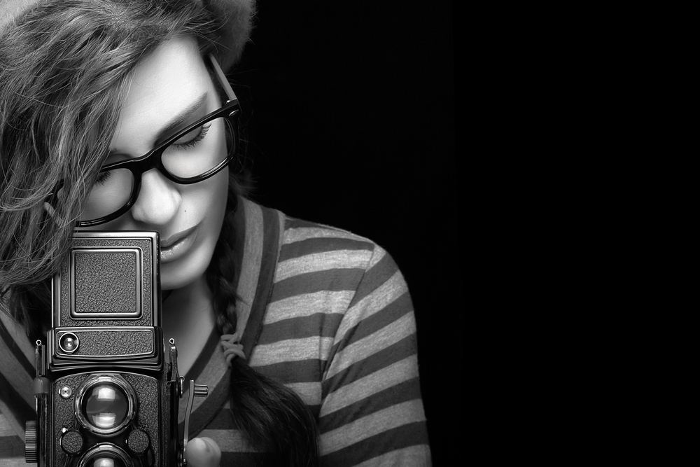 girl photographer camera black and white hair stripes glasses TLR viewfinder world photo day