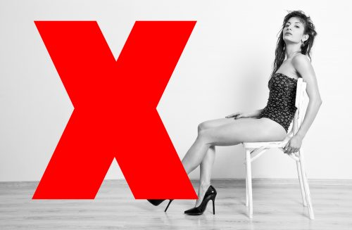 model table black and white leaning bodysuit red cross incorrect chair