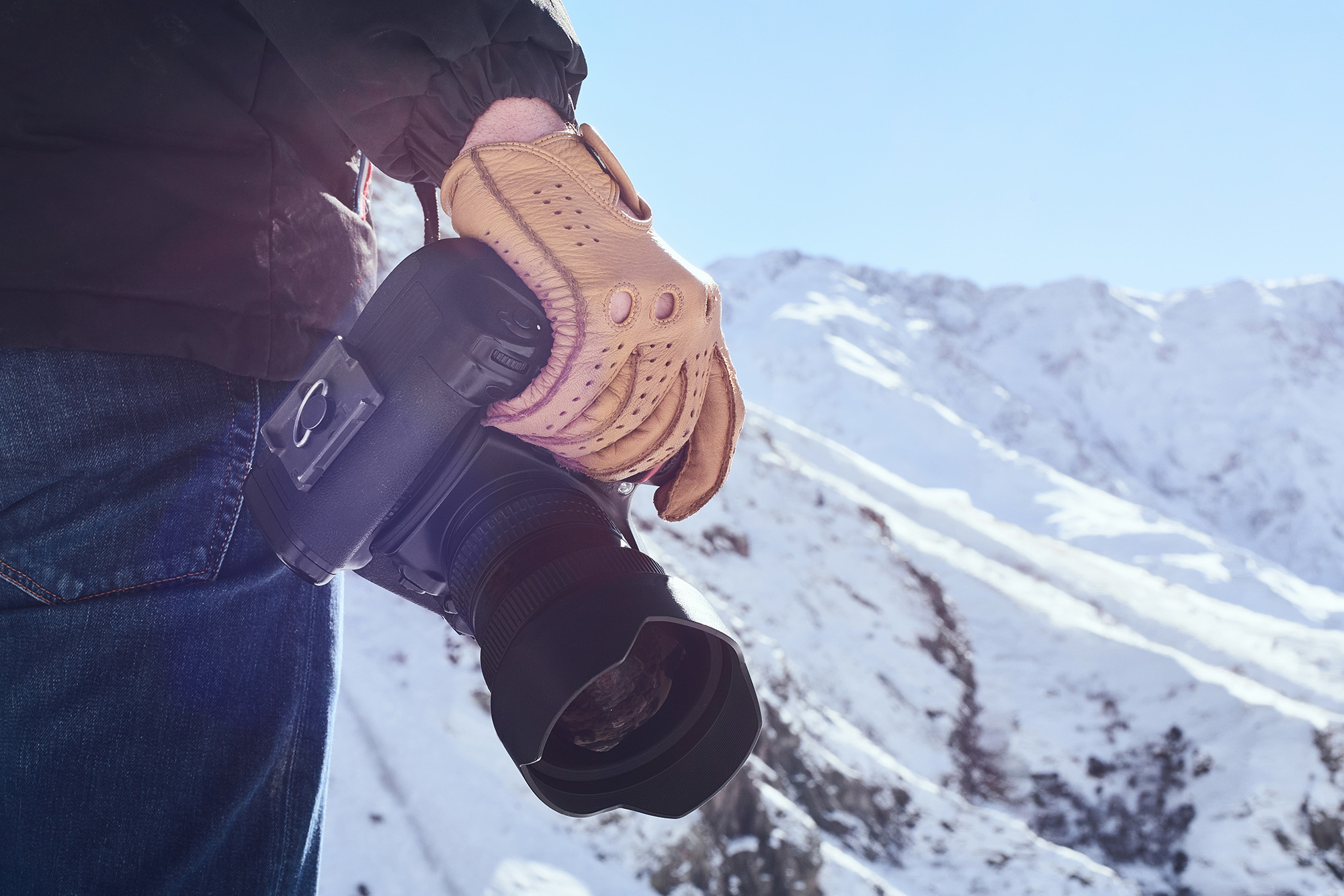 photographer camera dslr mountain snow glove blue sky