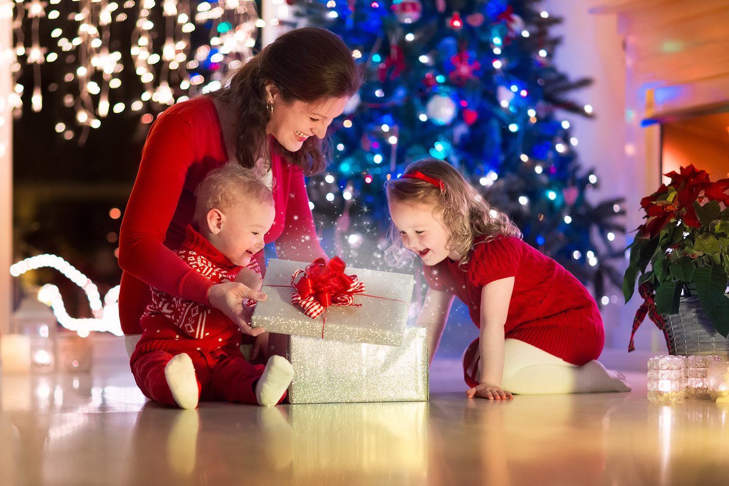 christmas eve parent mother children presents tree lights twinkling