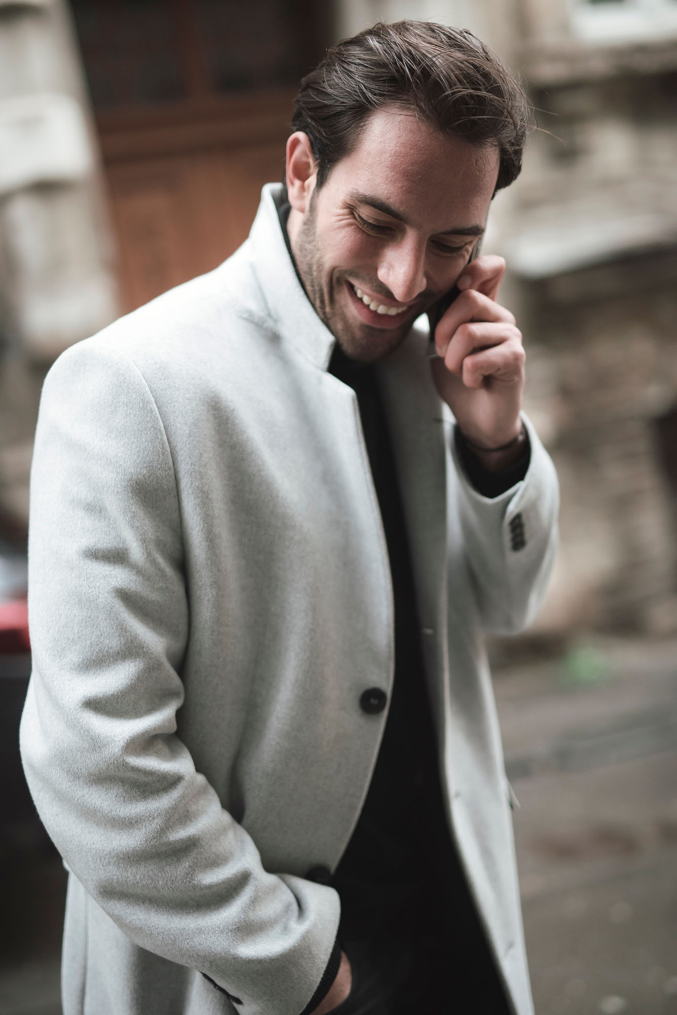 man talking on phone white coat street photography portrait city people camera subject light how to tutorial guide