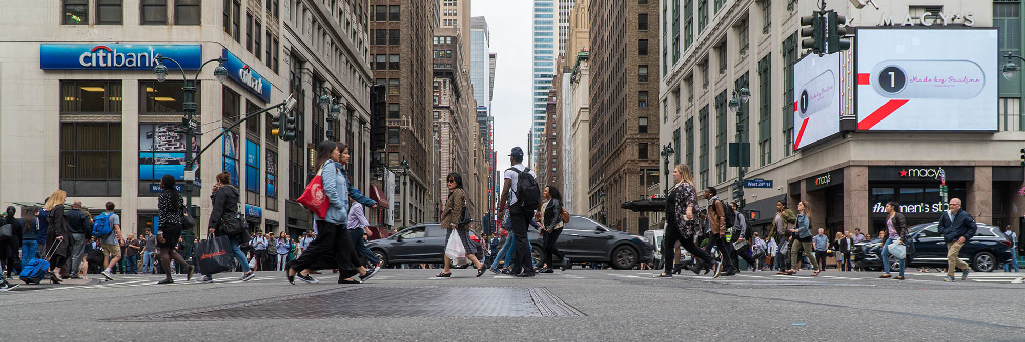 low angle city panorama cross walk road tarmac walking crowded street photography portrait city people camera subject light how to tutorial guide