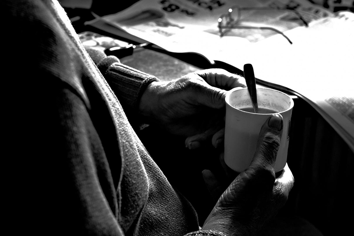 hands holding a cup with a spoon in it street photography portrait city people camera subject light how to tutorial guide