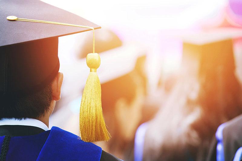 graduate college university cap matriculate yellow tassel ceremony